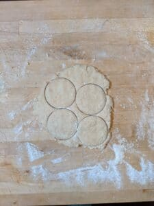Cutting the sourdough butter biscuits
